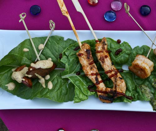 Creative chicken and greens at a catered event.