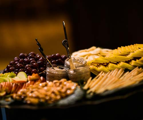 Cheese and meat plate with grapes.